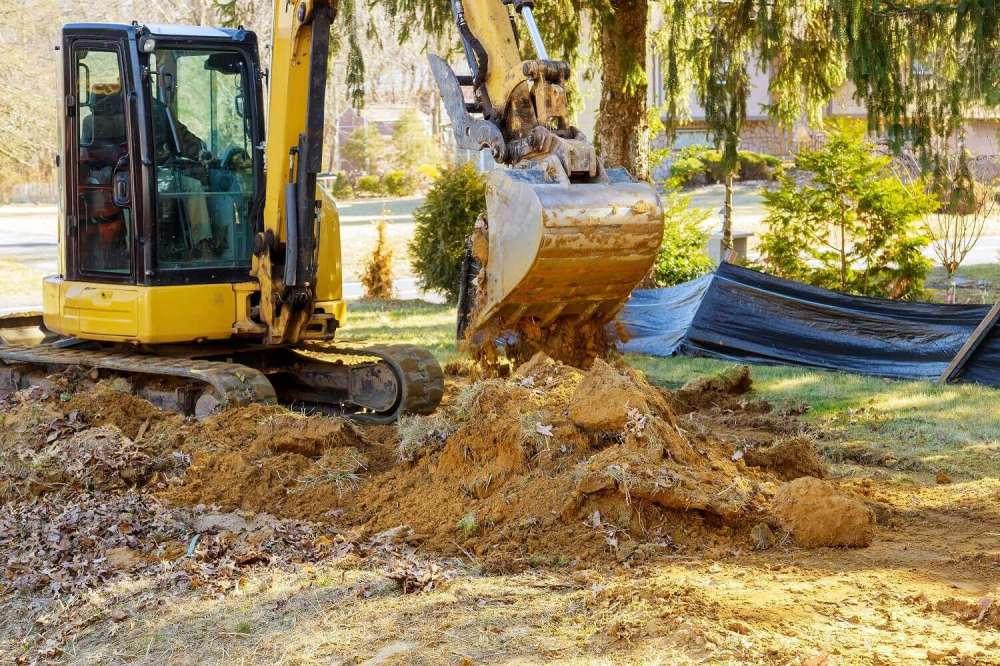 maszyny budowlane przy budowie domu